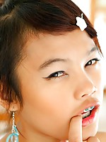 Petite Thai babe with braces strips to prepare to get fucked