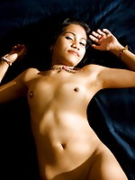 Really beautiful Thai babe strips and spreads her pussy