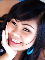 Pretty Thai girl with braces that make her look so innocent