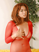 Busty Mai Ly in fishnet bodystocking