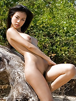 Busty Miko nude by the sea