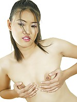 Innocent looking Thai girlfriend poses and strips