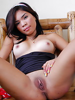 Petite Leela spreads her legs to show her mouth watering bald pussy