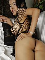 Classy Thai escort girl flashing her inviting tools of mass seduction