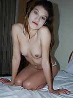 University student shyly undressing in a hotel room to make some cash