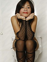 Cute Thai model posing and spreading in the toilets