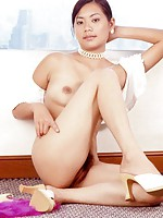 Superb Thai model strips and spreads her legs in a posh Bangkok