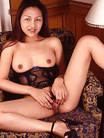 Busty Thai model showing her hairy holes on a sofa