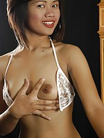 Thai bargirl in lingerie stripping to show her tits and her shaved slit