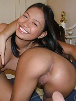 Two Filipina girls licking their wet shaved poontang