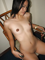19 year old Trina strips and spreads her legs to show her neat hairless slit