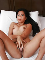Cute young Mia spreads her legs and her pussy lips for our voyeuristic pleasure
