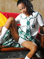 Petite girl stripping from her school uniform to flash her firm bubble butt and her tight slit
