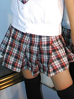 Adorable college student lifting her school skirt to flash her soft peach