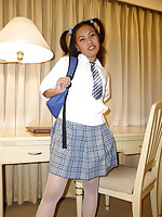 Cute schoolgirl in pigtails spreading her legs to show some pink