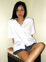 Tall student dropping her white cotton panties to show her slit