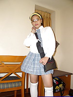 Petite schoolgirl fitted with big boobs and some neat shaved love holes