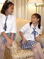 Cute schoolgirls tonguing their adorable shaved peaches