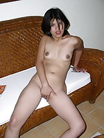 Lonely Asian girl stripping to finger her bald twat after school