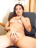 Sexy female student stripping to show her bald pussy