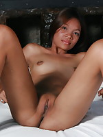 Hot chick stripping and spreading her ass cheeks to flash her brown love holes