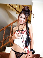 Very petite Thai girl Tong strips out of her traditional dress