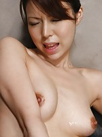 Gorgeous Rino Asuka oils herself up for frisky vibrator play