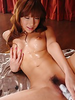 Naughty Serina Hayakawa oils up her body and toys it