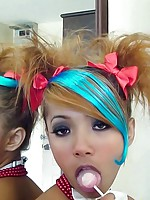 Beautiful emo Thai babe Air sucks a lolipop and teases us with her mouth
