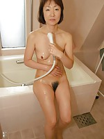 Japanese granny Yukiko Ishii plays with sex toys until her cooch get creamy wet.