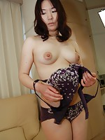 Japanese MILF Aki Tanihara moans in excitement as hard cock penetrates her pussy.