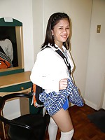 Teen girl stripping of her school uniform and spreading her ass cheeks