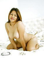 Naturally busty Thai beauty Aom strips to show her huge tits and nice pussy