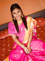 Exotic teen Asha covers her brown India titties with a sari