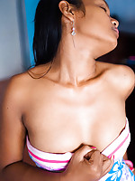 Foxy Indian babe lifts sundress to flash her brown buns
