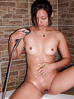 Amateur half Asian girl makes her pussy wet in tub