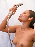 Indian Asha Kumara oiled and soaking wet in the shower