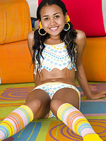 Petite Joon in a colorful outfit shows smooth landing strip
