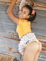 Foxy Asian teen give an upskirt peek to show petite buns
