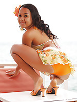Tropical island teen in orange shorts shows her bubble butt