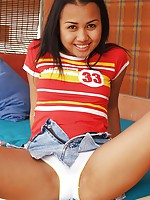 Joon Mali in jean skirt plays with panties and pinwheel
