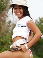 Asian teen flashes petite boobs and bubble buns outdoors