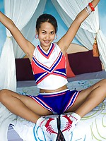 Delicate Asian teen cheerleader flashes cotton panties