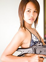Asian Military girl Lily shows off her sexy bikini and gun