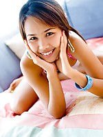 Lily Koh smiles playfully and stretches out her Asian frame