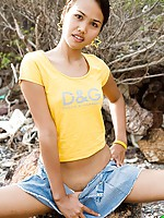 Adorable Thai teen slides panties down her slender legs