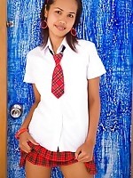 Sexy teen Lily Koh dressed in red plaid schoolgirl outfit