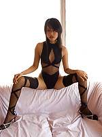 Slender Lily Koh shows her exotic long legs in stockings