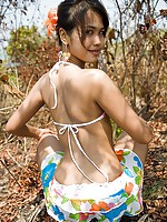 Nubile slim Thai exposes her tight teen virgin buns outside