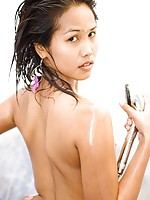 Sexy Asian cutie naked and covered in soap and oil shower
